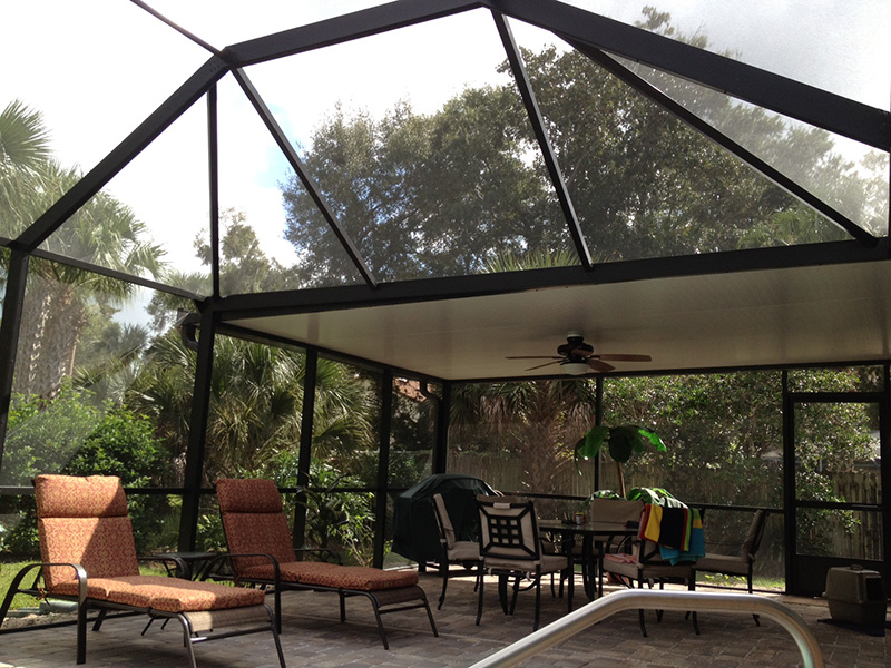 mansard style pool enclosure with elite roof and fan beams by east coast aluminum