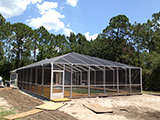 Freestanding pool enclosure with hip gable roof by East Coast Aluminum