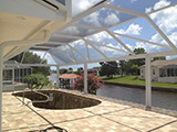 Mansard style pool enclosure with picture view walls by East Coast Aluminum
