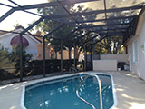 Modified mansard style pool enclosure by East Coast Aluminum