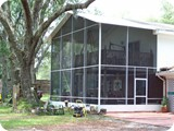 Two story screen enclosure added to Palm Coast home by East Coast Aluminum