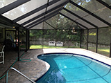 Pool enclosure with gable roof by East Coast Aluminum